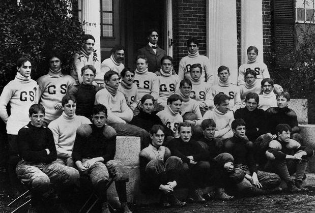 October 1899, one year before Harvard. Lathrop Brown, the football team manager is at the top of the stair, in tie. FDR is in the white turtle neck in the second row, third from left. The boys in dark jerseys are clearly the squad. Those with letters? Varsity? FDR's shirt is blank...