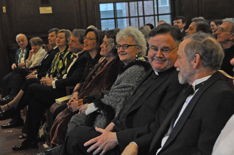 The front row of eager lecture attendees, with Father George and Sean Palfrey at the far right