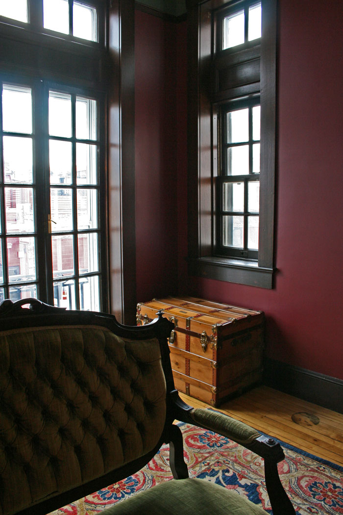 The view towards the French windows, with our Brimfield railroad chest in the corner. Window treatments are the next step and will alter this view substantially.